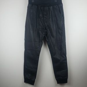 Black pants not leather but 100% Polyester size XL